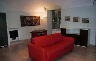 progetto restyling monolocale zona pranzo divano